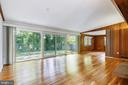 Living room with full wall sliding doors - 6801 GRANBY ST, BETHESDA