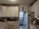 Kitchen access to laundry and garage. - 745 & 747 MERRIMANS LN, WINCHESTER
