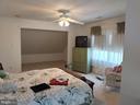 Upper bedroom with sitting area. - 745 & 747 MERRIMANS LN, WINCHESTER