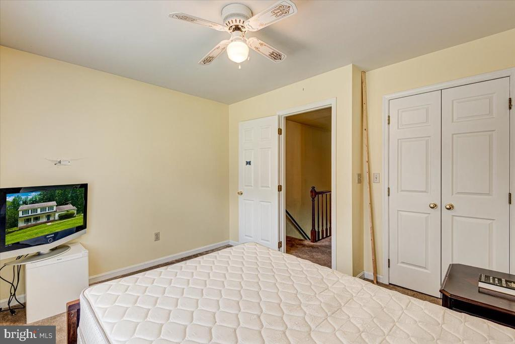 Closet with French Doors and Ceiling Fan in BR 1 - 2376 RIVER DR, KING GEORGE