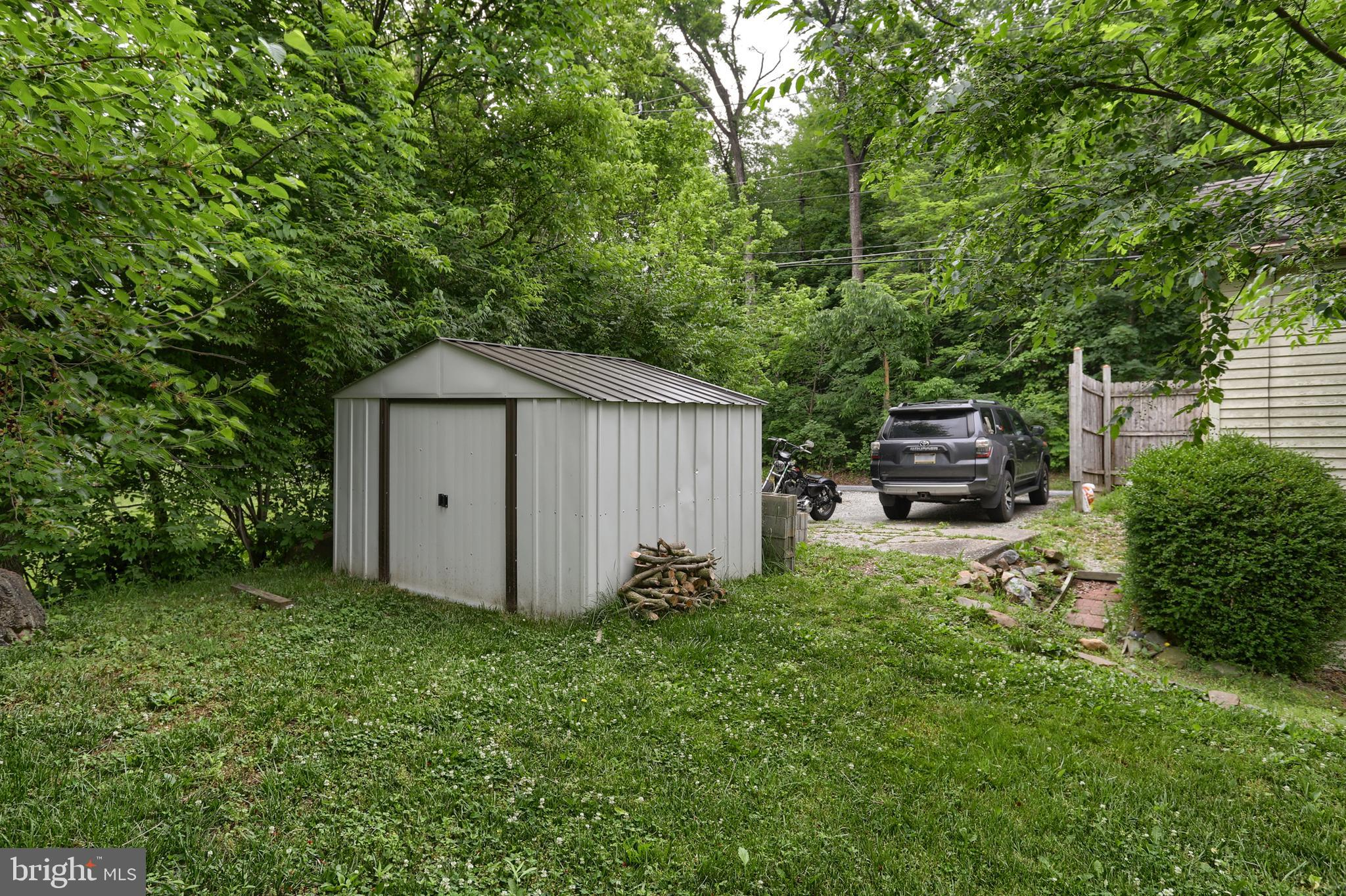 Metal Shed & Driveway Parking Area