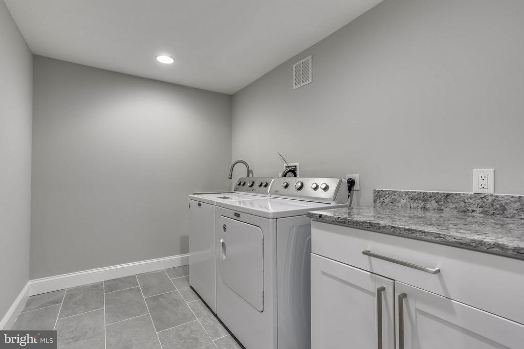 Sink and storage in laundry room - 1948 SEMINARY RD, SILVER SPRING