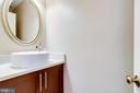 Half bath adjacent to kitchen area - 6705 WASHINGTON BLVD #G, ARLINGTON