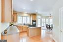 White Quartz Countertops line kitchen cabinets - 4525 MOSSER MILL CT, WOODBRIDGE