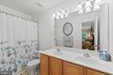 Main Level Primary Bath with Dual Sinks - 17318 ARROWOOD PL, ROUND HILL