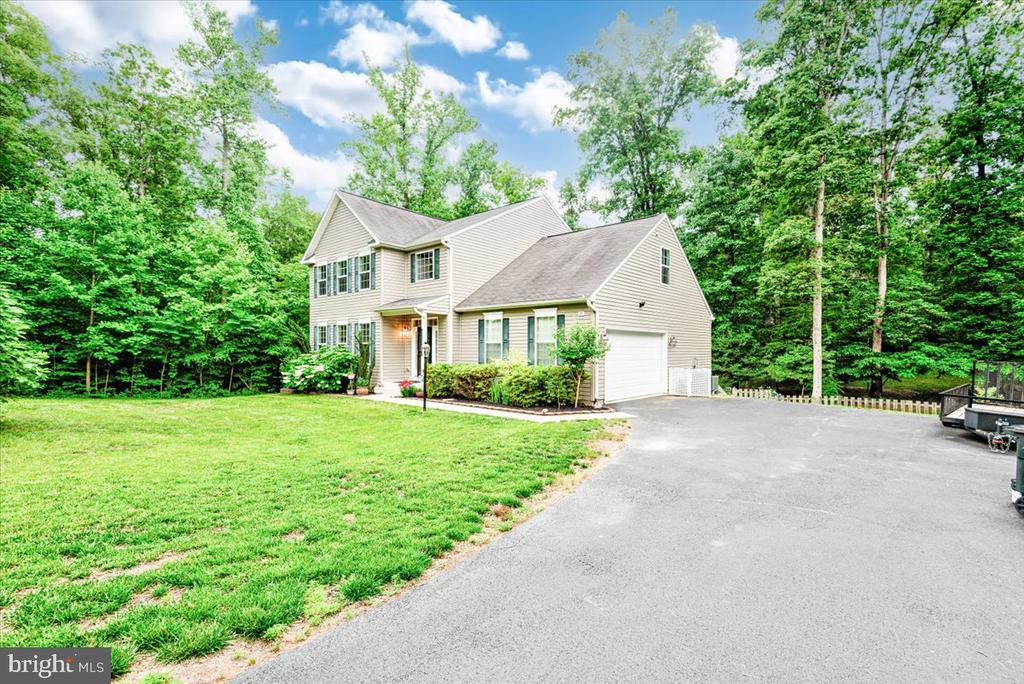 Located on 3.8 wooded acres on cul-de-sac. - 26 BLOSSOM TREE CT, STAFFORD