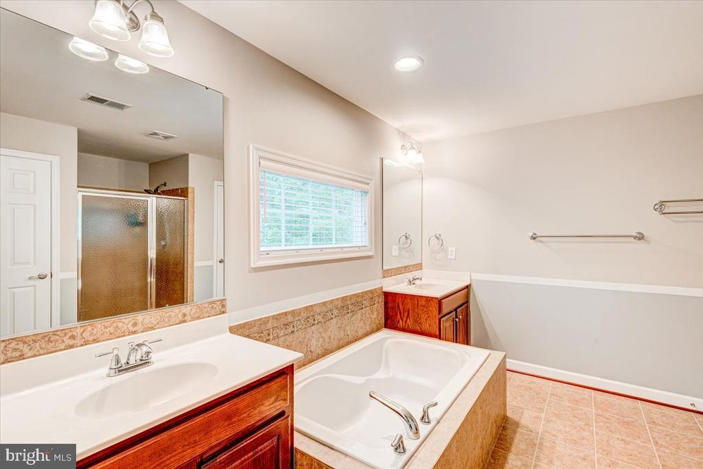 Primary bath w/soaking tub and sep shower. - 26 BLOSSOM TREE CT, STAFFORD