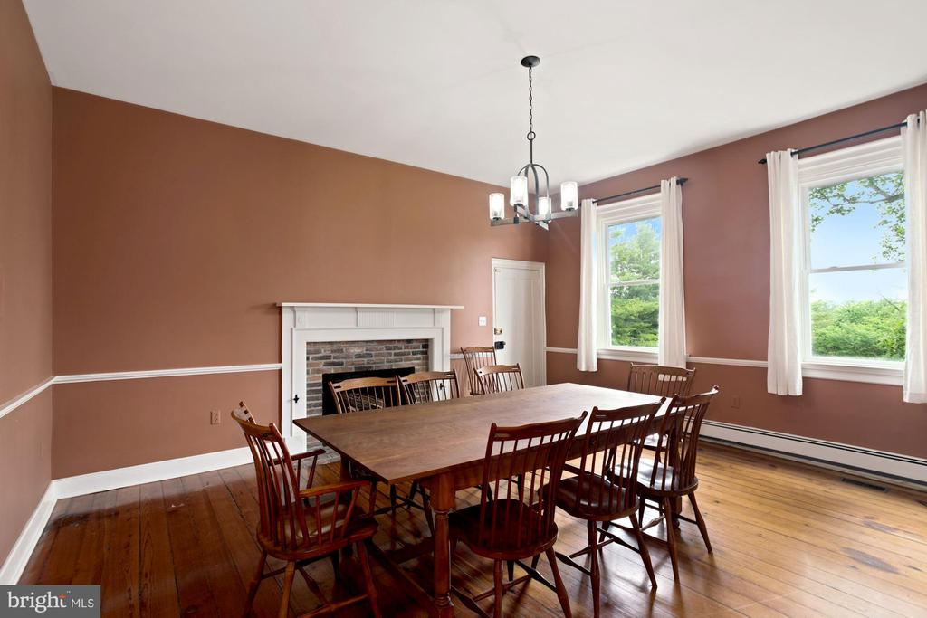 Dining room with fireplace off kitchen and center - 675 LIME MARL LN, BERRYVILLE