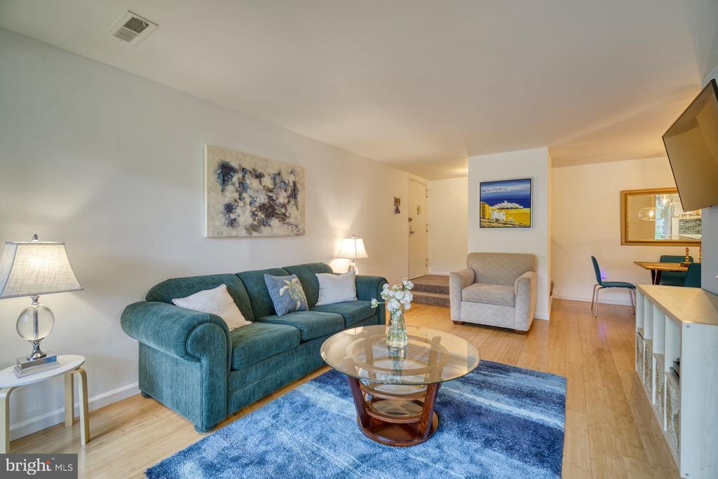 Living Room has bamboo floors - 11236 CHESTNUT GROVE SQ #164, RESTON