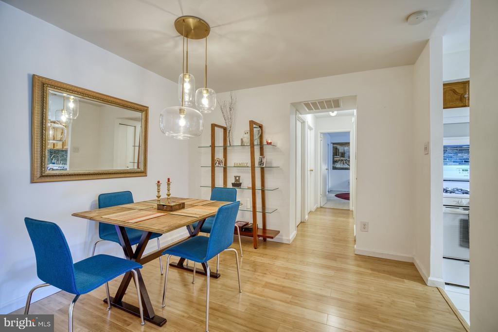 Dining Room with decorative lighting - 11236 CHESTNUT GROVE SQ #164, RESTON