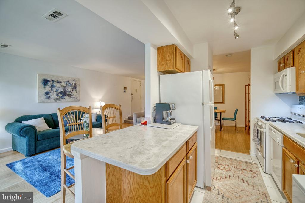 Kitchen renovated by opening the wall. - 11236 CHESTNUT GROVE SQ #164, RESTON