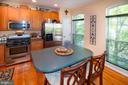 Kitchen island with Corian countertops - 5000 DONOVAN DR, ALEXANDRIA