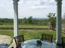 View from covered porch in summer - 21943 ST LOUIS RD, MIDDLEBURG