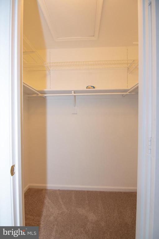 Upper Level Primary Bedroom Walk-In Closet - 11415 HOLLOW TIMBER WAY, RESTON