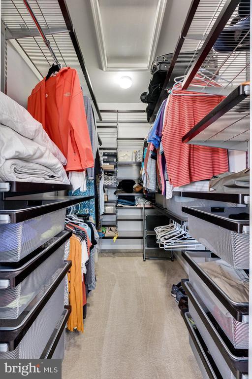 Primary bedroom walk in closet w custom organizers - 42965 EDGEWATER ST, CHANTILLY