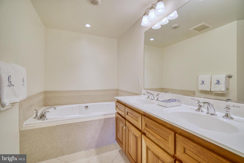 Large primary bathroom with double sinks... - 1830 FOUNTAIN DR #604, RESTON
