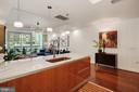 Kitchen - Britannica Gold Quartz Counter Tops! - 1881 N NASH ST #307, ARLINGTON