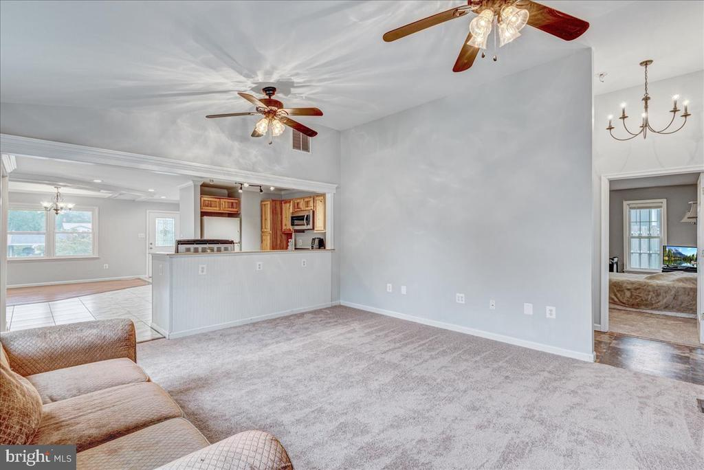 Family Room view into kitchen and dining area. - 222 AUSTIN, STAFFORD