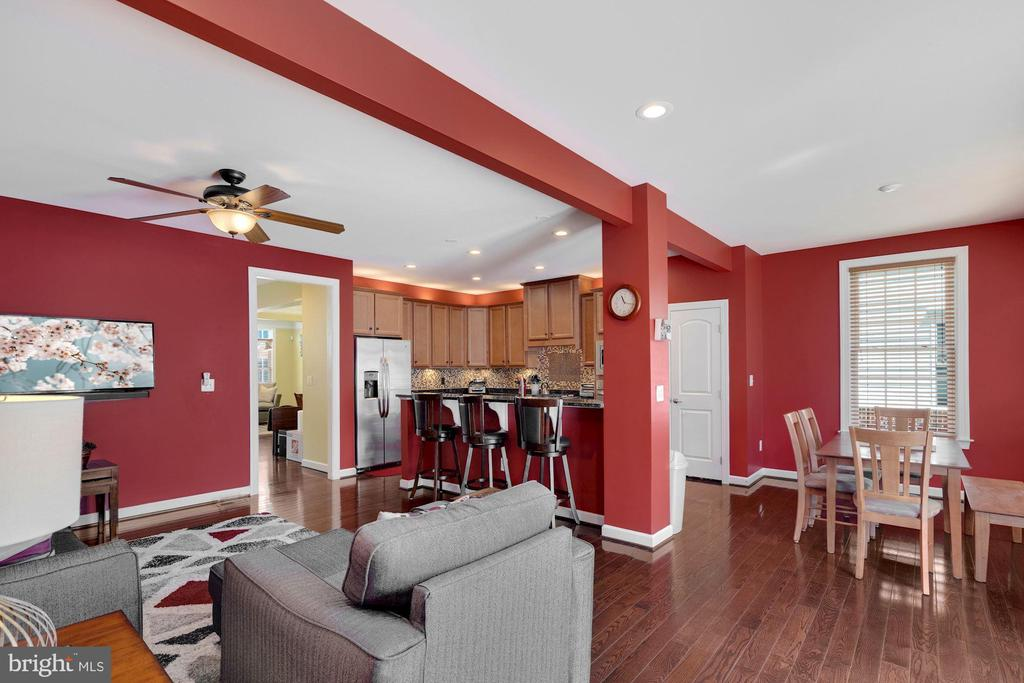 View of the family room, breakfast room & kitchen. - 21260 PARK GROVE TER, ASHBURN