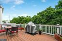 Trex deck backing to tree view - 21260 PARK GROVE TER, ASHBURN