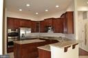 Kitchen with upgraded cabinets and Appliance - 24104 STONE SPRINGS BLVD, STERLING