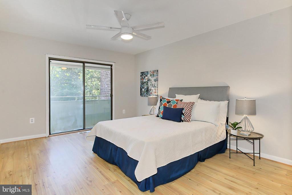 Primary bedroom w/ balcony (sliding door replaced) - 2045 WETHERSFIELD CT, RESTON