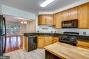 Spacious Kitchen with Granite Counters - 1597 LEEDS CASTLE DR #101, VIENNA