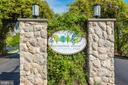 ENTRANCE TO SECURE GATE HOUSE - 19385 CYPRESS RIDGE TER #102, LEESBURG