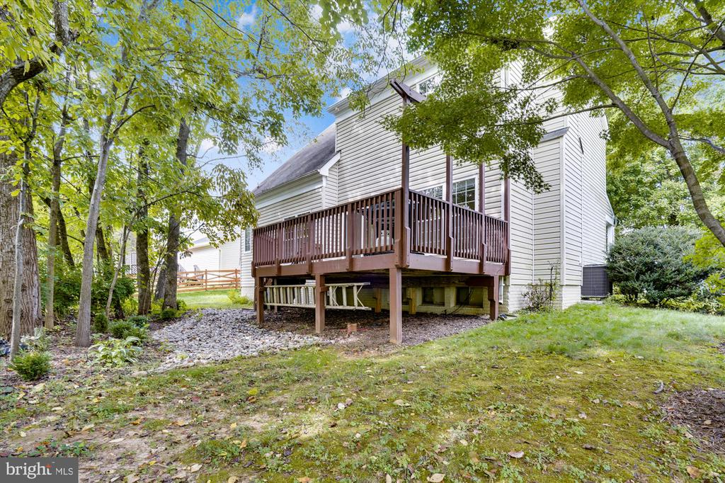 REAR VIEW OF HOME WITH DECK - 20672 PARKSIDE CIR, STERLING