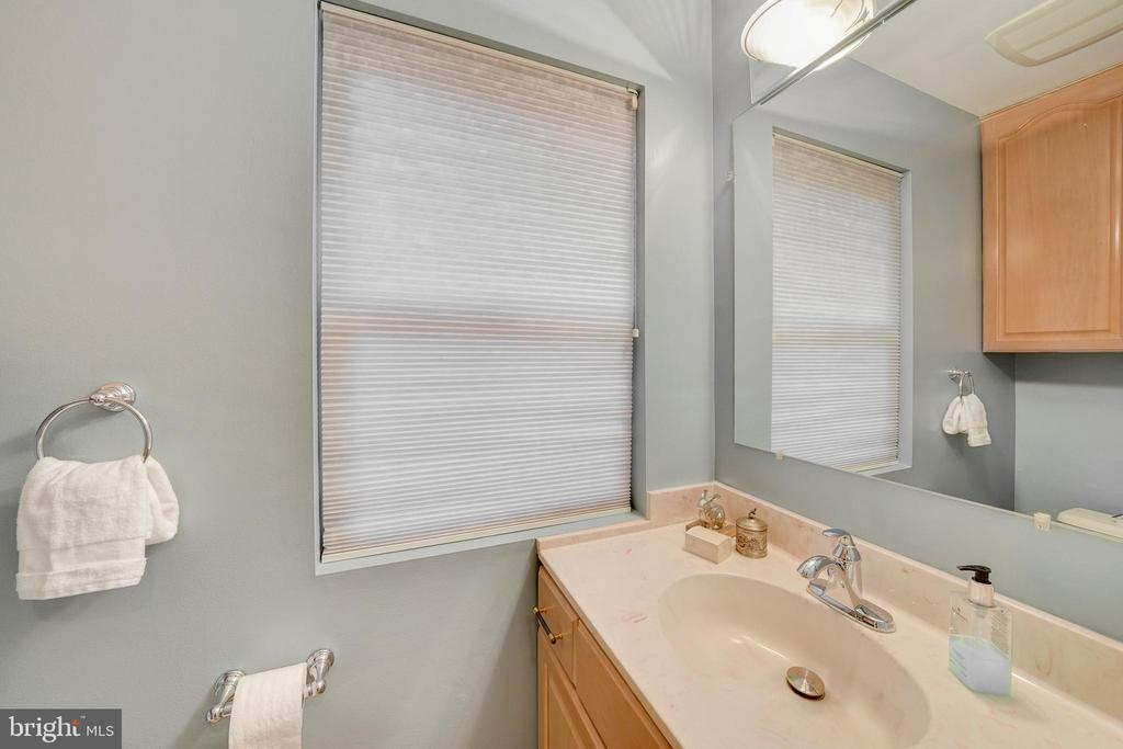 powder room with large vanity and storage cabinet - 4427 7TH ST N, ARLINGTON