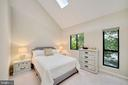 open airy primary bedroom with treed views - 4427 7TH ST N, ARLINGTON