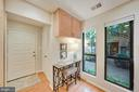 Covered entry opens to foyer with coat closet - 4427 7TH ST N, ARLINGTON