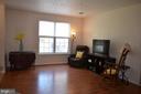 New wood-look laminate flooring in living room - 4900 EDGEWARE TER, FREDERICK