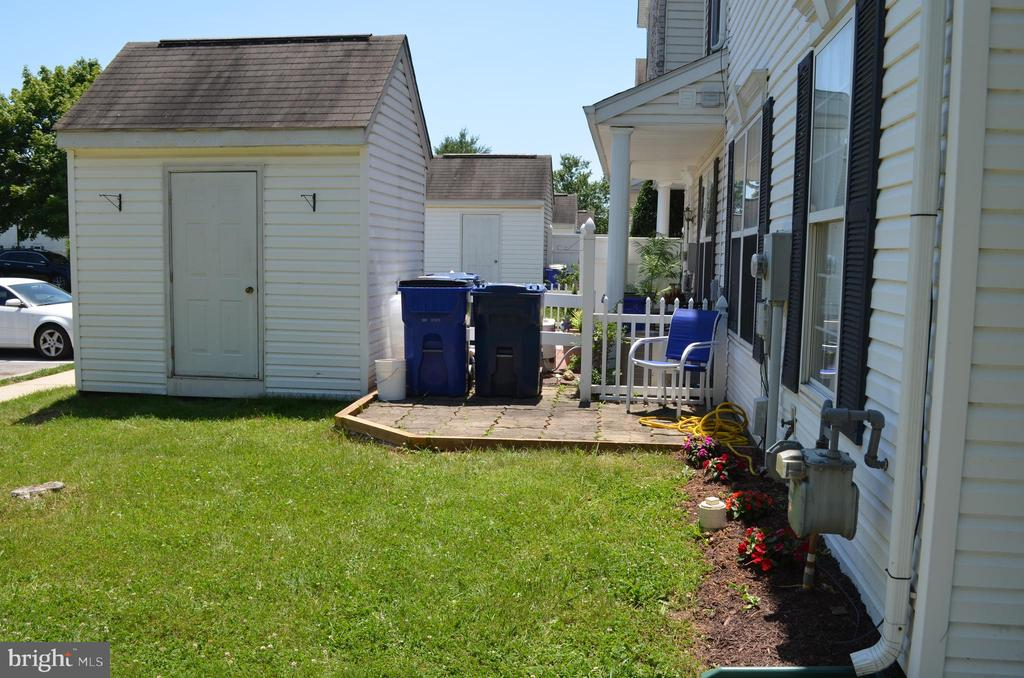 Shed and front patio with flower garden - 4900 EDGEWARE TER, FREDERICK