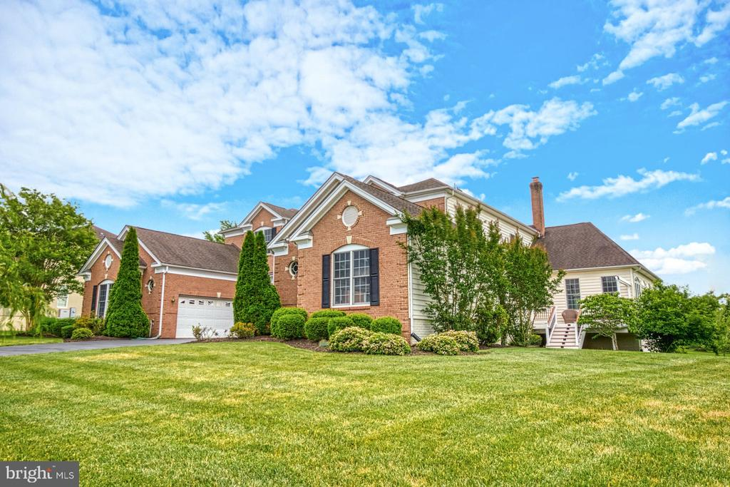 THE HOME IS LOCATED ON AN EXPANSIVE .56 ACRE LOT - 20003 BELMONT STATION DR, ASHBURN