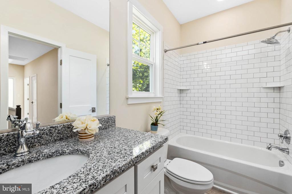 granite and subway tile in hall bath - 418 BIRDIE RD, LOCUST GROVE