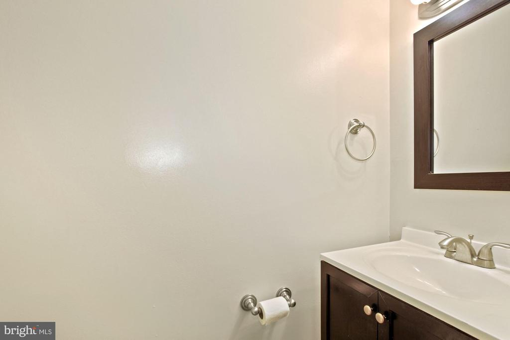 The half bath on the main level. - 9761 HAGEL CIR #E, LORTON