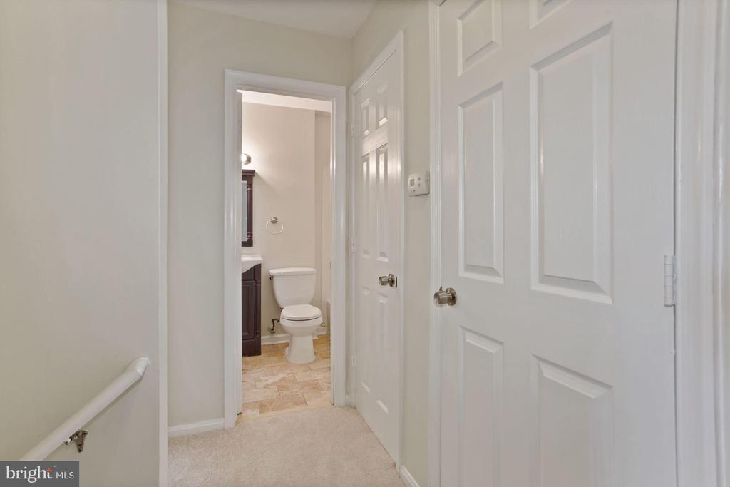 The upper level hallway. - 9761 HAGEL CIR #E, LORTON