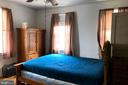 Bright front bedroom, hardwood floors, ceiling fan - 4639 A ST SE, WASHINGTON