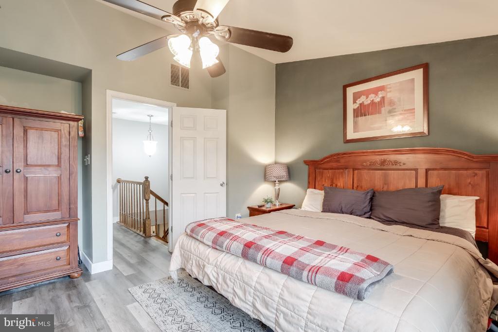 Master bedroom - new Luxury Vinyl Tile flooring - 8288 WATERSIDE CT, FREDERICK