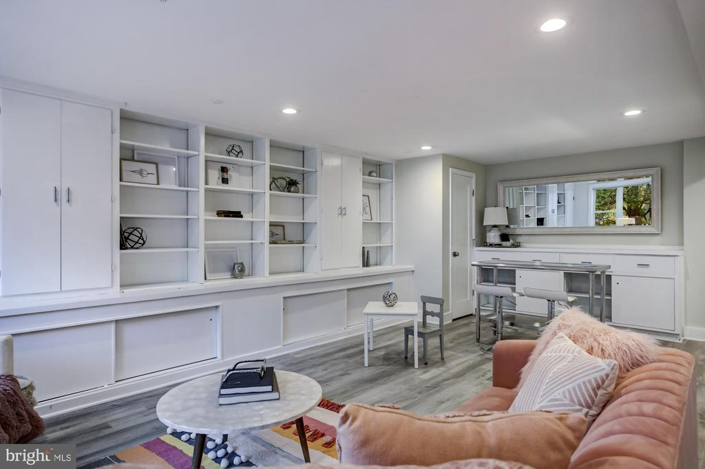 Lower level has built-in shelving - 5507 DURBIN RD, BETHESDA