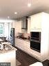 Open Gourmet Kitchen with White Cabinets - 12012 N SHORE DR, RESTON