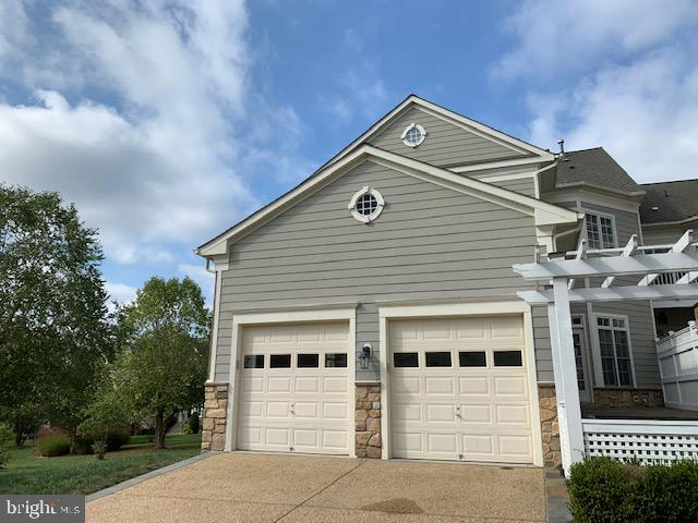 2 car garage and gate to patio and rear entrance - 43512 STARGELL TER, LEESBURG