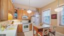 eat-in kitchen with large windows - 100 E 2ND ST, FREDERICK