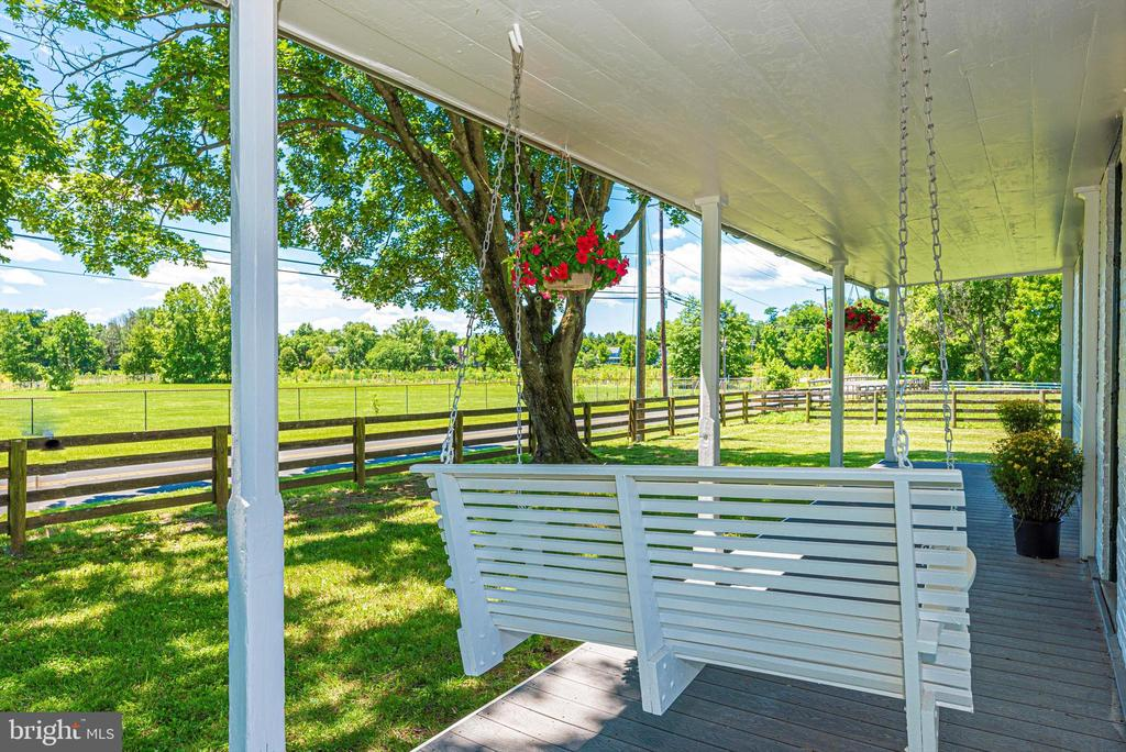 The front porch swing - 10302 COPPERMINE RD, WOODSBORO