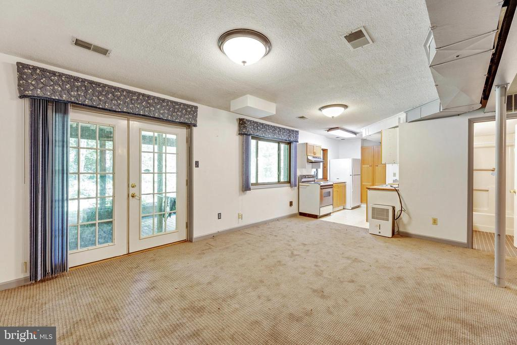 French doors lead out to a covered patio space! - 3208 SHOREVIEW RD, TRIANGLE
