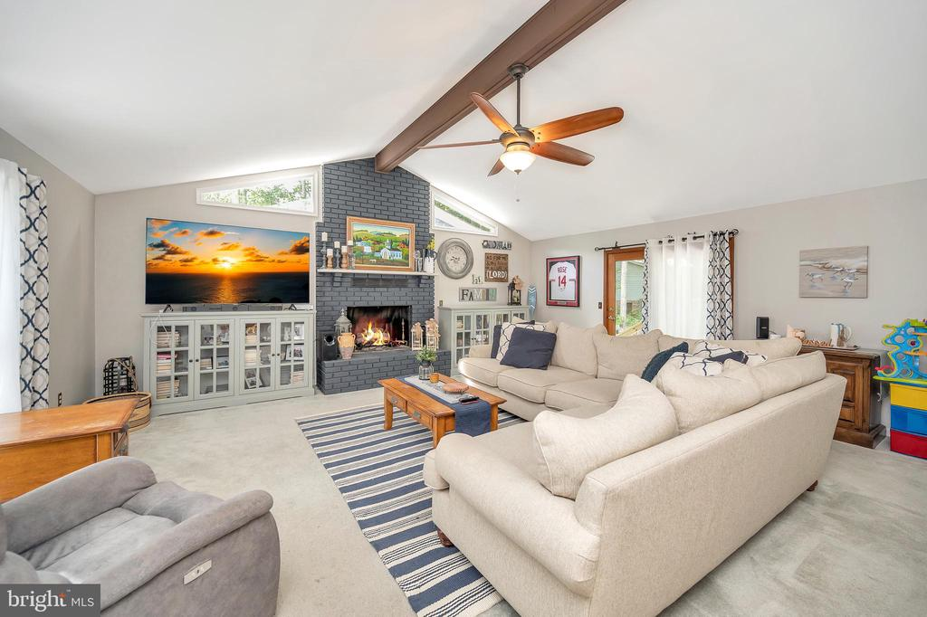 Spacious Living Room with Vault Ceiling . gas fp - 141 EAGLE CT, LOCUST GROVE