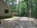 view from driveway to backyard - 201 HAPPY CREEK RD, LOCUST GROVE