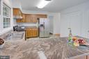 The kitchen boasts beautiful granite counters - 320 DESTROYER CV, STAFFORD