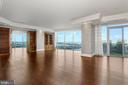 Floor to ceiling windows allow ample light in! - 1881 N NASH ST #2311, ARLINGTON